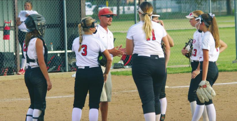 Hinton High School varsity softball head coach Garrett Hannah talks to his infielders on Sept. 19, 2019, during a road game against Watonga High School. The Lady Comets' 2020 slow-pitch season was canceled in March due to COVID-19. ANDREW SALMI/HINTON RECORD