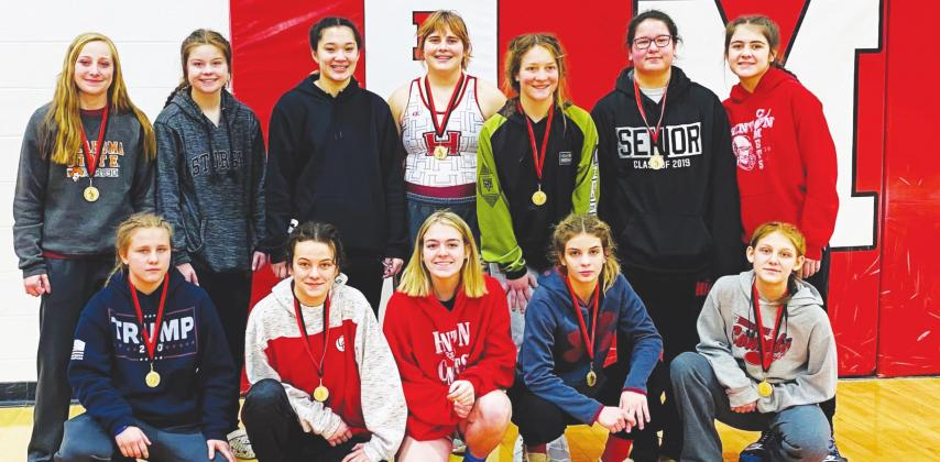 Members of the Hinton girls wrestling team pose for a photo with two girls from Davis after a match in Mcloud. Hinton team members are Lela Harp, April Smith, Rain Van-Tassel, Brooklynn Helmuth, Elli Turner, Talli Taylor, Destiny Brown, Kailey Worthley, Anna Kilpatrick and Savanna Lagoona (Photo provided)