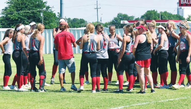 (Above) The Hinton High School varsity fast-pitch softball team huddles around third-year head coach Garrett Hannah on Thursday, June 25 prior to a summer league scrimmage vs. Rock Creek High School at Kiwanis Sports Complex in Hinton. PHOTOS COURTESY OF MELISSA WEATHERS/HINTON RECORD