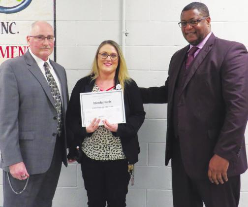 (Above L to R) Facility Administrator Ralph Hanson, executive secretary Mandy Davis who was named as GEO 2019 employee of the year, and GEO Vice President for the Central Region, James Black. GEO GROUP/HINTON RECORD